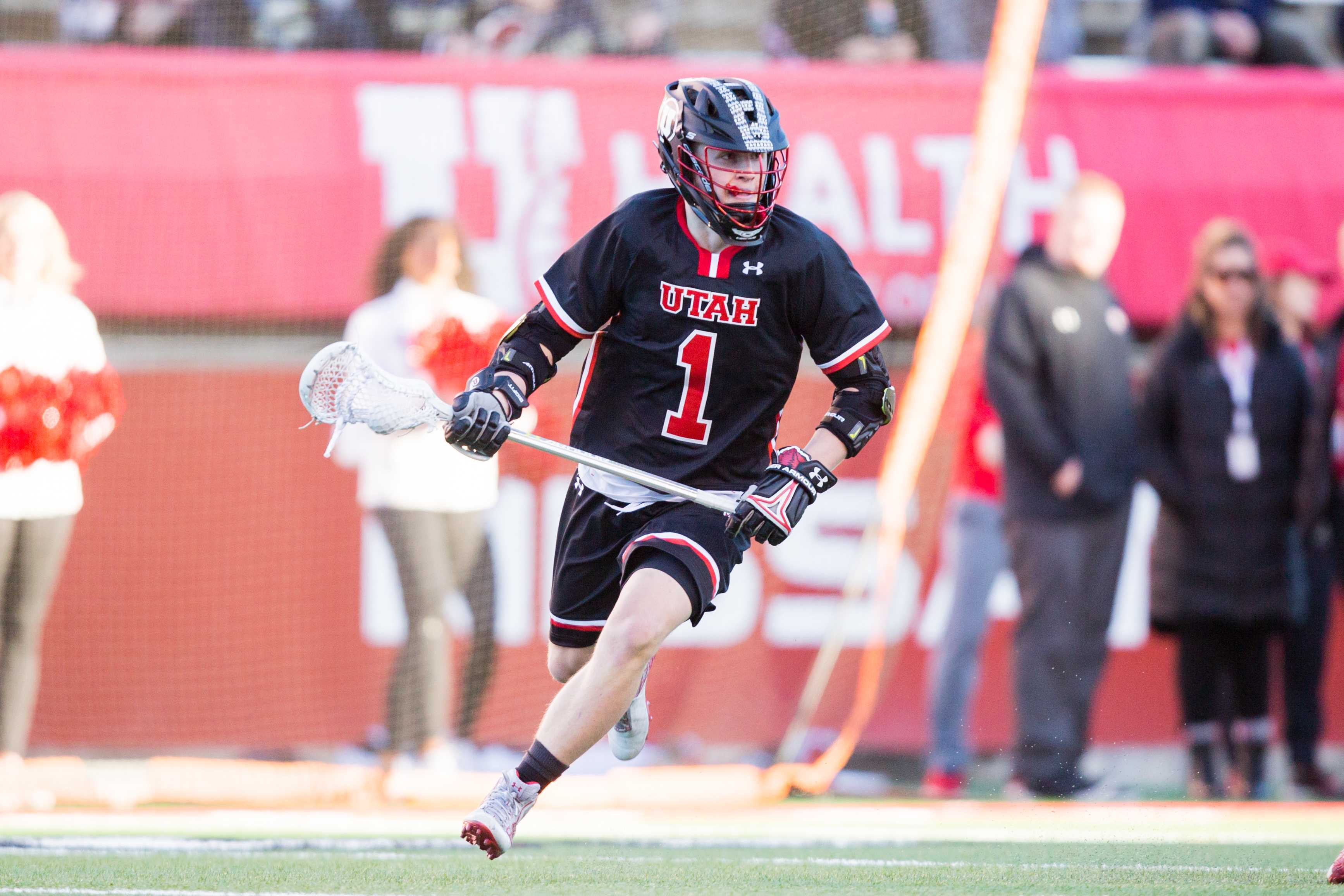University of Utah sophomore attacker Josh Stout (1) looked to pass the ball off in an NCAA Men's Lacrosse game vs. Vermont at Rice-Eccles Stadium in Salt Lake City, UT on Friday February 01, 2019.  (Photo by Curtis Lin | Daily Utah Chronicle)