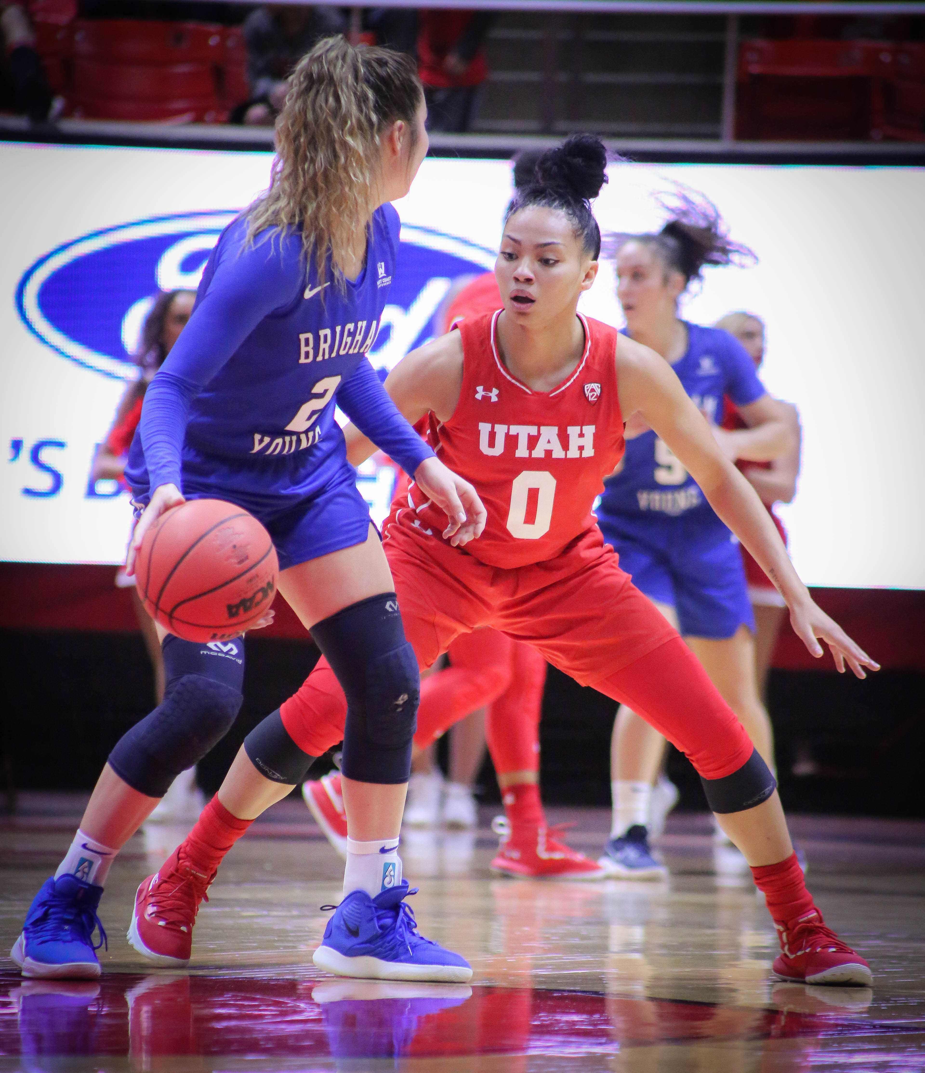 Kiana Moore (0) defends her opponent as The University of Utah Utes take on Brigham Young University at the Huntsman Center in Salt Lake City, UT on Saturaday, Dec. 8, 2018 (Photo by Cassandra Palor | The Daily Utah Chronicle)