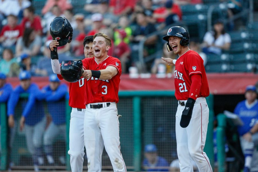 DeShawn Keirsey (9), Oliver Dunn (3) and Ryyker Tom (21) wait at home plate for Chandler Anderson (16) as theUtes take on the BYU Cougars at Smith's Ballpark May 8, 2018.  (Photo by: Justin Prather / Daily Utah Chronicle).