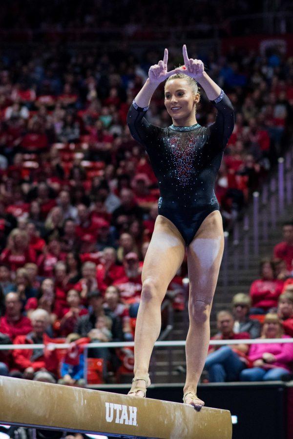 University of Utah senior Makenna Merrell-Giles threw up the U while performing her beam routine in an NCAA Women's Gymnastics meet vs. UCLA at Jon M. Huntsman Center in Salt Lake City, UT on Saturday February 23, 2019.  (Photo by Curtis Lin | Daily Utah Chronicle)
