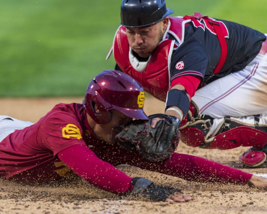 University of Southern California senior infielder Chase Bushor (15) gets tagged out by University of Utah redshirt junior catcher Zack Moeller (28) after a 9-4-2 during an NCAA Baseball game at the Smiths Ballpark in Salt Lake City, Utah on Thursday, April 11, 2019. (Photo by Kiffer Creveling | The Daily Utah Chronicle)