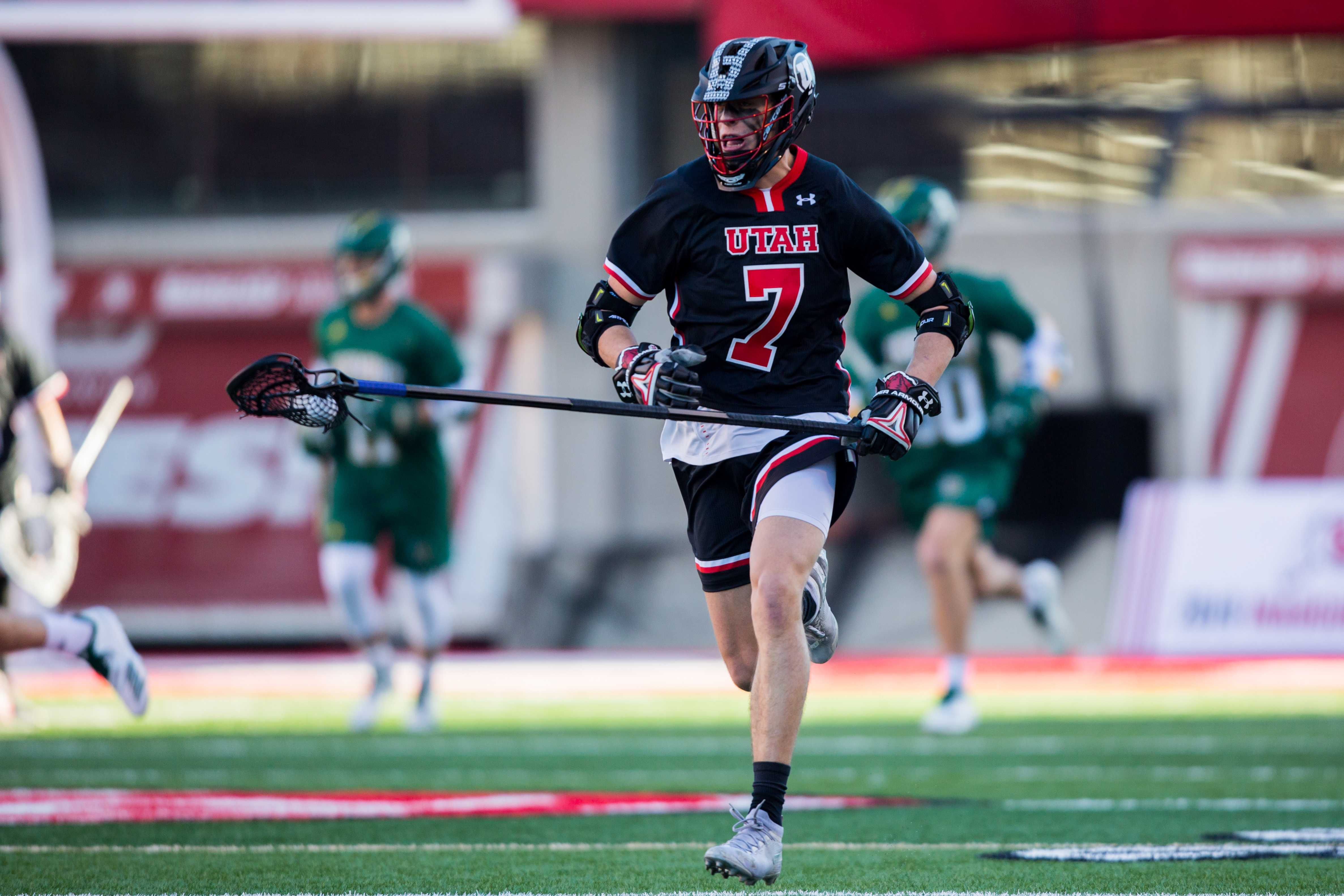 University of Utah freshman long stick middie Chris Belcher (7) ran the ball up field in an NCAA Men's Lacrosse game vs. Vermont at Rice-Eccles Stadium in Salt Lake City, UT on Friday February 01, 2019.  (Photo by Curtis Lin | Daily Utah Chronicle)