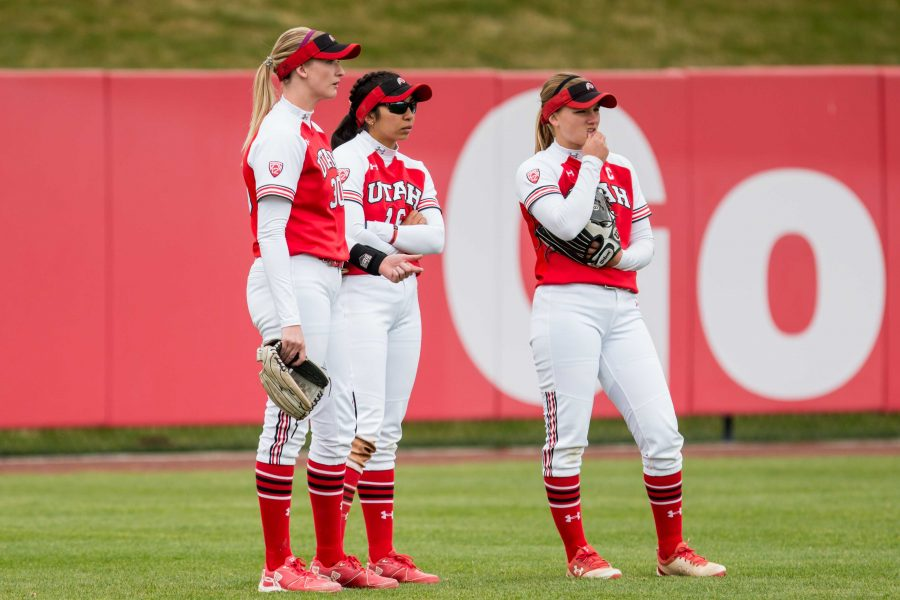 The University of Utah Softball Teams outfielders huddled up in an NCAA Softball game vs. Arizona at Dumke Family Softball Field in Salt Lake City, UT on Saturday April 06, 2019.  (Photo by Curtis Lin | Daily Utah Chronicle)