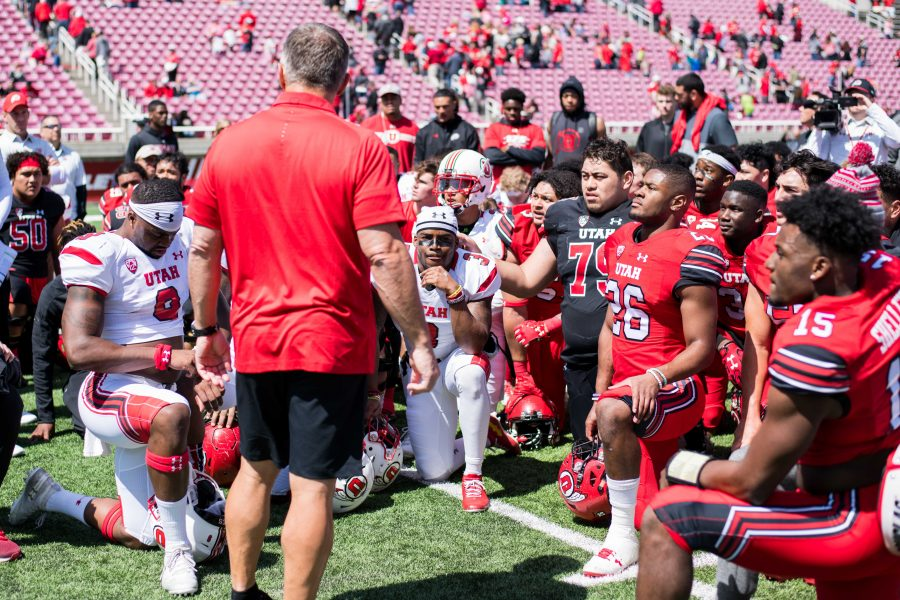 University of Utah head coach Kyle Whittingham talks to players during the Utah Red and White Game at Rice Eccles Stadium in Salt Lake City, UT on Saturday April 14, 2018.  (Photo by Curtis Lin/ Daily Utah Chronicle)