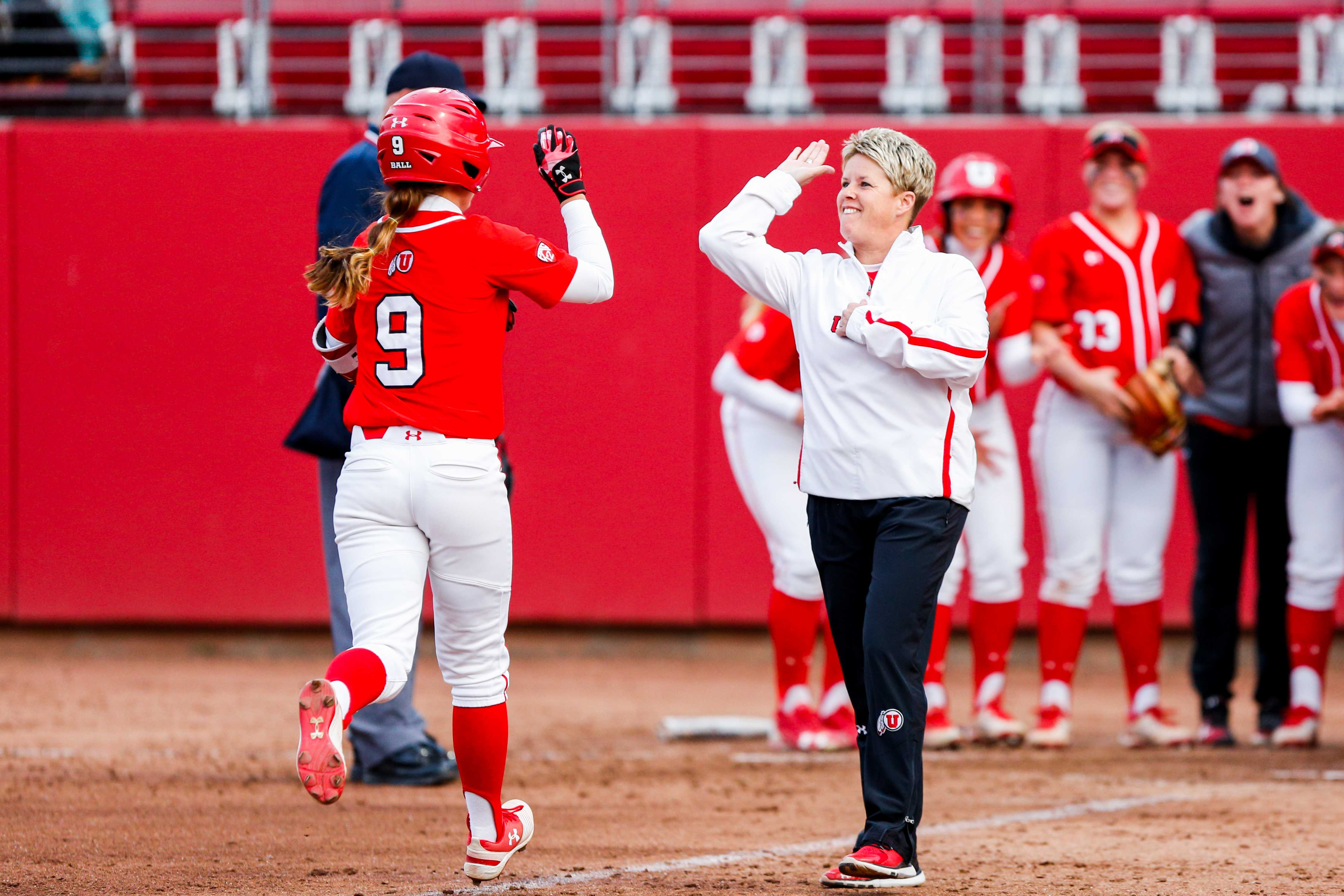 University of Utah Softball team celebrate after a homer by sophomore infielder Ryley Ball (9) during an NCAA Softball game vs the BYU Cougars at Dumke Family Softball Stadium in Salt Lake City, UT on Wednesday April 18, 2018.  (Photo by Curtis Lin | Daily Utah Chronicle)