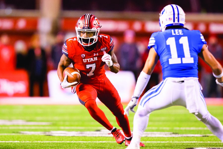 University+of+Utah+junior+wide+receiver+Demari+Simpkins+%287%29+ran+after+catching+a+pass+from+freshman+quarterback+Jason+Shelley+%2815%29+in+an+NCAA+Football+game+vs.+BYU+at+Rice-Eccles+Stadium+in+Salt+Lake+City%2C+UT+on+Sunday+November+25%2C+2018.%0A%0A%28Photo+by+Curtis+Lin+%7C+Daily+Utah+Chronicle%29