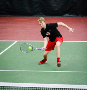 Utah's Joe Wooley returns a volley against Montana State at the Eccles Tennis Center February 5, 2017. Michael Adam Fondren for the Daily Utah Chronicle.