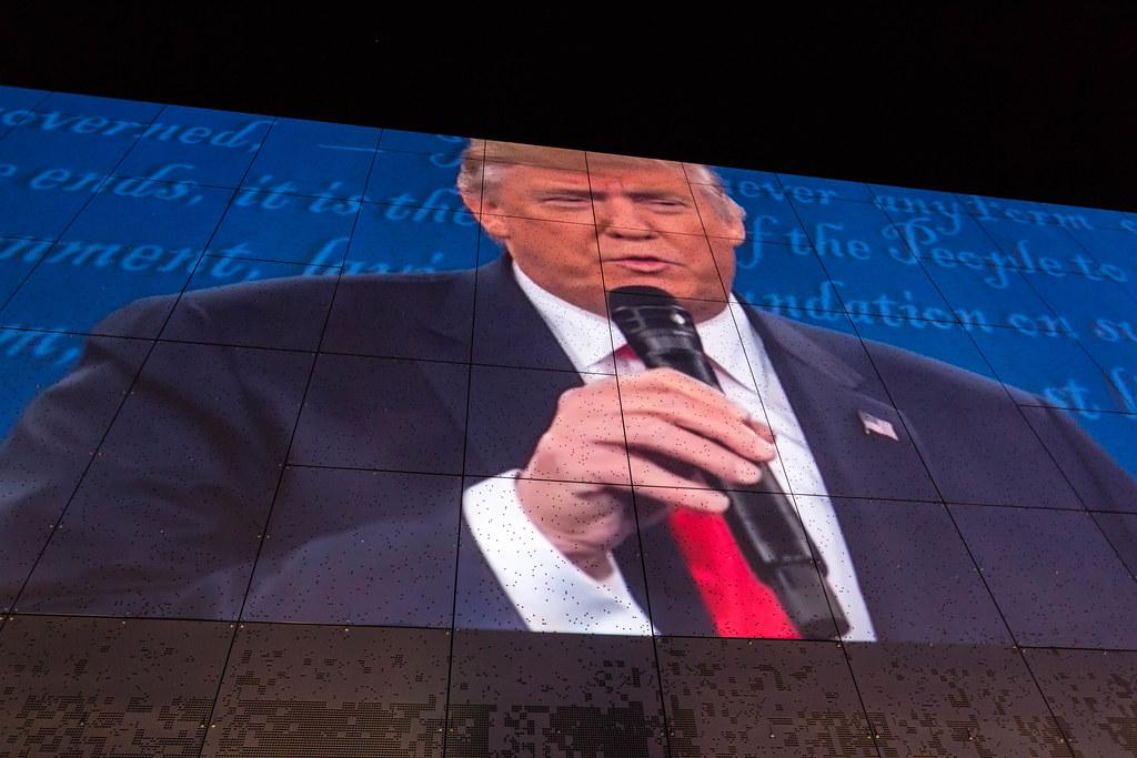 Donald Trump's image is projected on the side wall of Public Media Commons in St. Louis during the second presidential debate watch party. Courtesy Flickr.