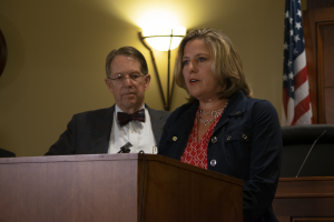 Jill McCluskey speaks at press conference