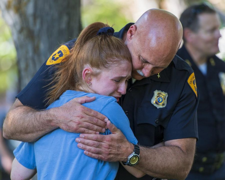 Salt Lake Police Chief, Mike Brown, embraces an attendant for a vigil in remembrance of MacKenzie Lueck at the University of Utah Student Union lawn in Salt Lake City, UT on Monday, July 1, 2019. (Photo by Kiffer Creveling | The Daily Utah Chronicle)
