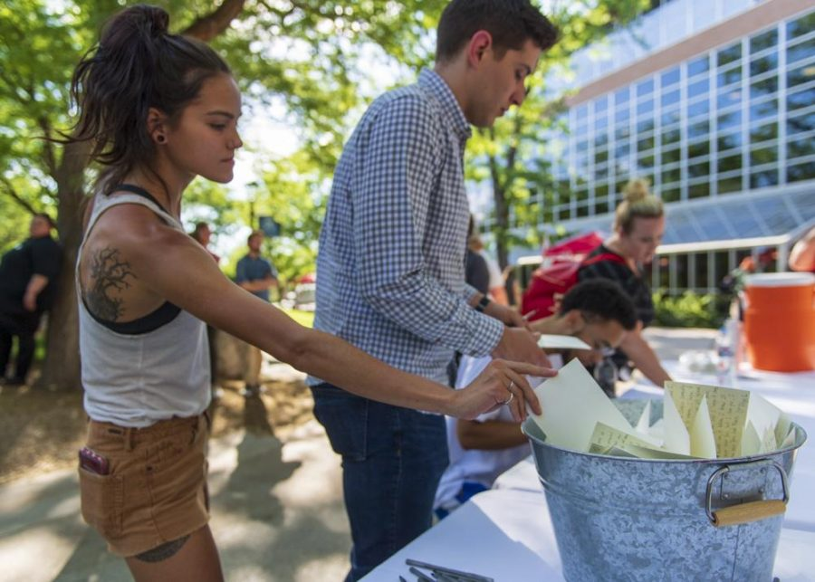 Students, staff and friends write down memories of MacKenzie. (Photo by Kiffer Creveling | The Daily Utah Chronicle)