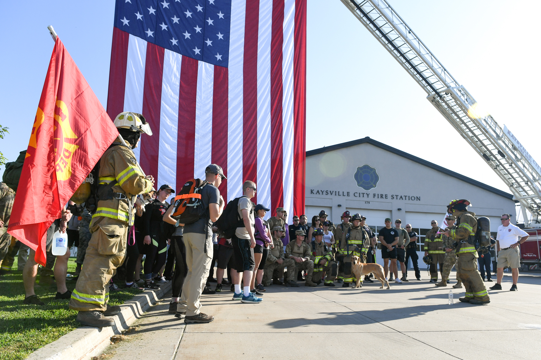 Staff Sgt. Caleb Saunders (far right), from the 775th Civil Engineering Squadron Fire Department, gives a reading about one of the 9/11 fallen at the Kaysville Fire Station during one of the stops of the 9/11 Memorial Ruck March. (Courtesy Hill Ail Force Base)