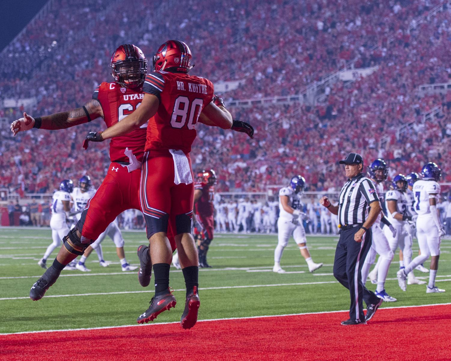 University of Utah freshman tight end Brant Kuithe (80) celebrates after scoring a touchdown during an NCAA Football game vs. the Weber State Wildcats at Rice Eccles Stadium in Salt Lake City, Utah on Thursday, Aug. 30, 2018. (Photo by Kiffer Creveling | The Daily Utah Chronicle)