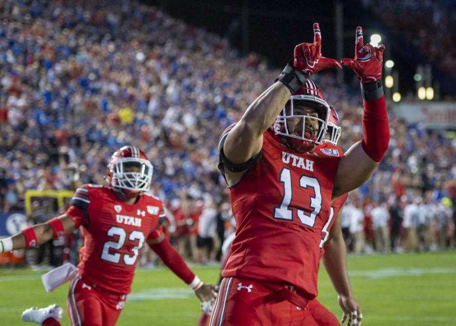 University of Utah senior linebacker Francis Bernard (13) runs for a touchdown after making an interception vs. Brigham Young University during an NCAA Football game at LaVell Edwards Stadium in Provo, Utah on Thursday, Aug. 29, 2019. (Photo by Kiffer Creveling | The Daily Utah Chronicle)