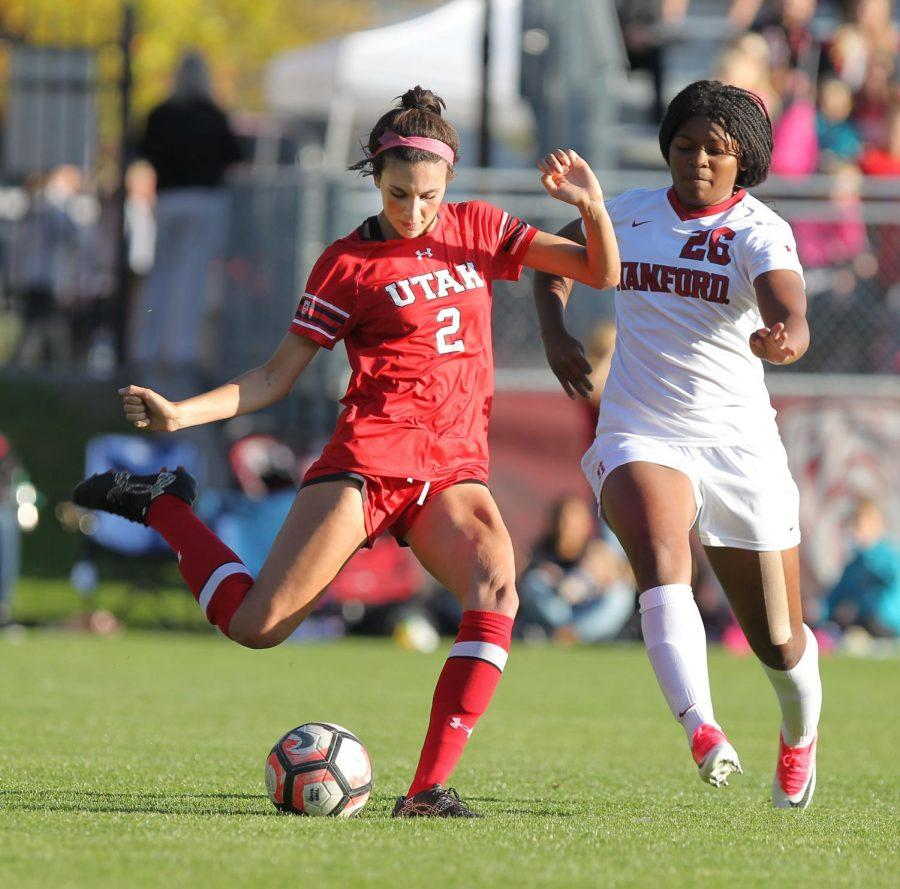 Tavia Leachman plays one on one with a Stanford player during a match. (Photo: Utah Athletics)