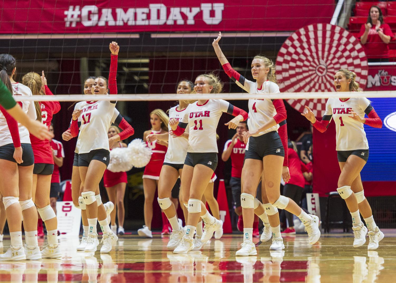 The University of Utah celebrates after their victory in an NCAA Volleyball match vs. UVU at the Jon M. Huntsman Center in Salt Lake City, Utah on Friday, Sept. 14, 2018 (Photo by Kiffer Creveling | The Daily Utah Chronicle)