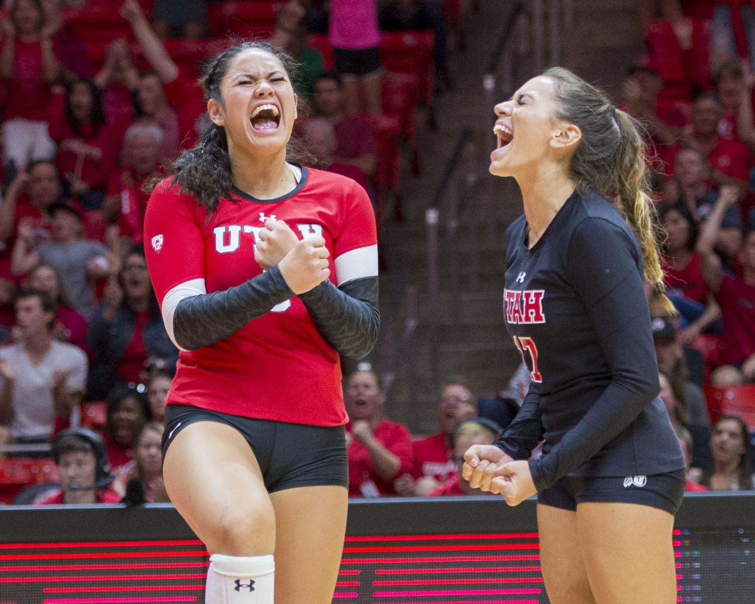 University of Utah freshman setter Saige Ka'aha'aina-Torres (9) and junior libero/defensive specialist Brianna Doehrmann (17) celebrate after a point in an NCAA Volleyball match vs. the UCLA Bruins at the Jon M. Huntsman Center in Salt Lake City, Utah on Friday, Sept. 21, 2018. (Photo by Kiffer Creveling | The Daily Utah Chronicle)