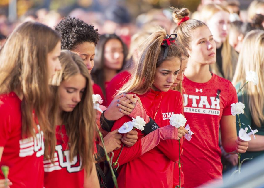 The Utah womens track and field team, students, staff, family and friends attend a vigil on the steps of the Park Building for Lauren McCluskey who was tragically killed on campus at The University of Utah in Salt Lake City, Utah on Wednesday, Oct. 24, 2018. (Photo by Kiffer Creveling | The Daily Utah Chronicle)