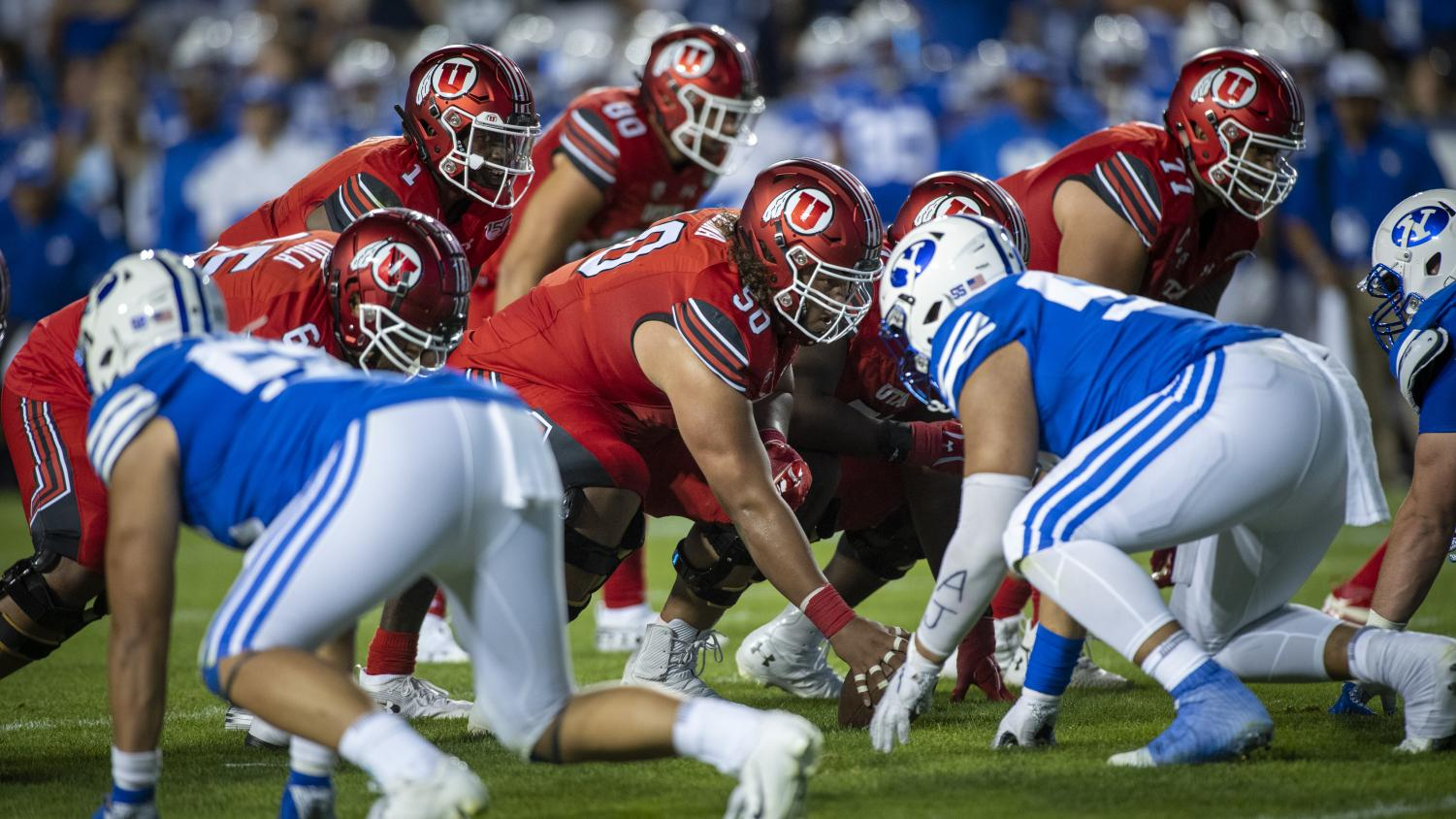 University of Utah junior offensive lineman Orlando Umana (50) snaps the ball during an NCAA Football game vs. Brigham Young University at LaVell Edwards Stadium in Provo, Utah on Thursday, Aug. 29, 2019. (Photo by Kiffer Creveling | The Daily Utah Chronicle)