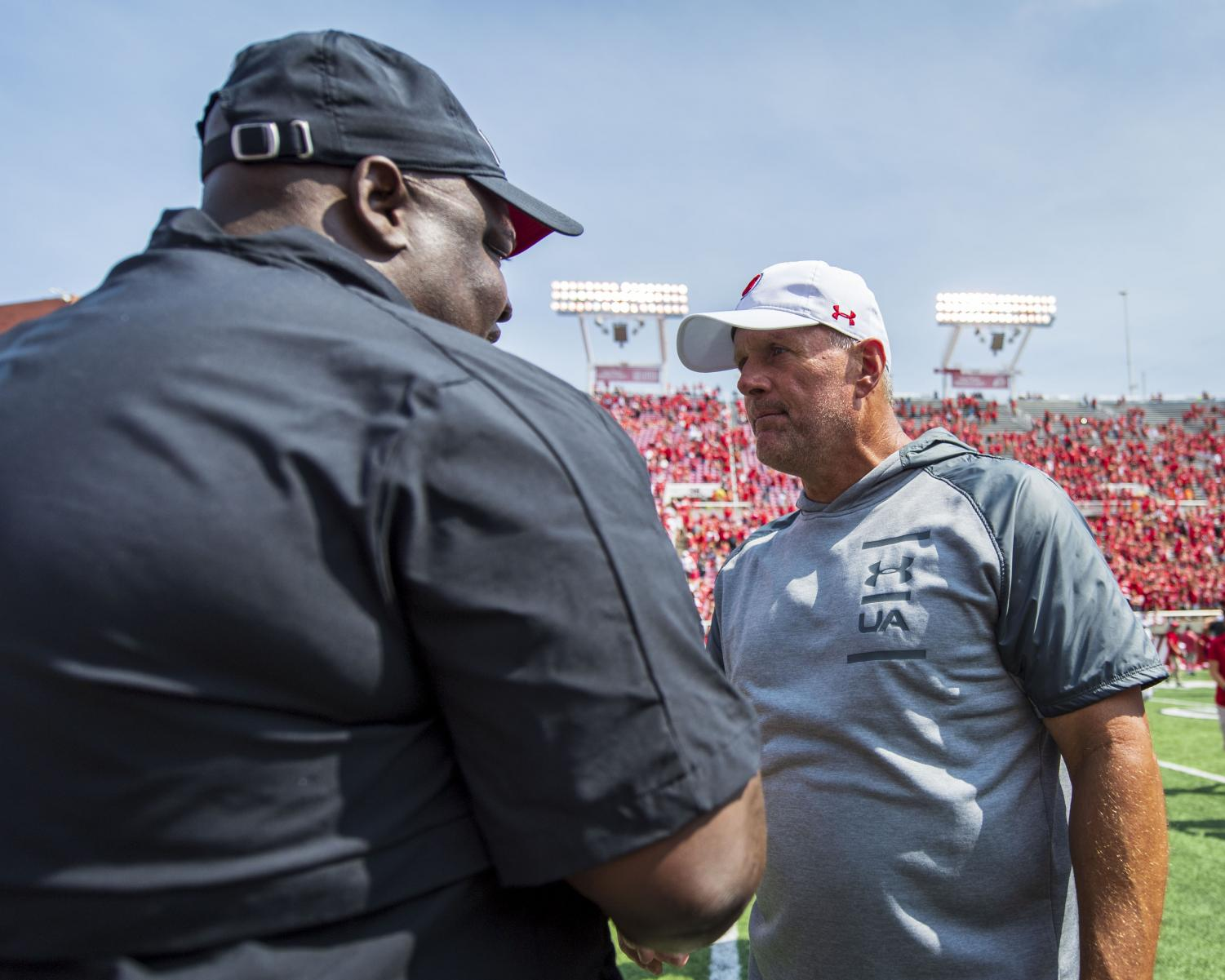 Northern Illinois University football head coach Thomas Hammock congratulates University of Utah football head coach Kyle Whittingham following an NCAA Football game at Rice Eccles Stadium in Salt Lake City, Utah on Saturday, Sept. 7, 2019. (Photo by Kiffer Creveling | The Daily Utah Chronicle)