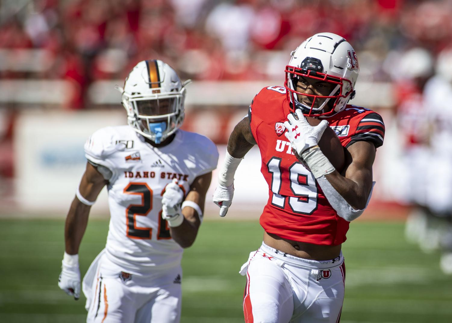University of Utah sophomore wide receiver Bryan Thompson (19) makes a catch and runs in to the endzone for a touchdown during an NCAA Football game vs. The Idaho State Bengals at Rice Eccles Stadium in Salt Lake City, Utah on Saturday, Sept. 14, 2019. (Photo by Kiffer Creveling | The Daily Utah Chronicle)