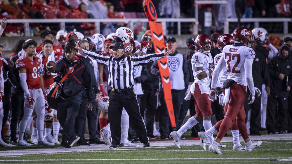A referee calls the catch by University of Utah sophomore wide receiver Solomon Enis (21) over Washington State defense no good during an NCAA Football game at Rice Eccles Stadium in Salt Lake City, Utah on Saturday, Sept. 28, 2019. (Photo by Kiffer Creveling | The Daily Utah Chronicle)