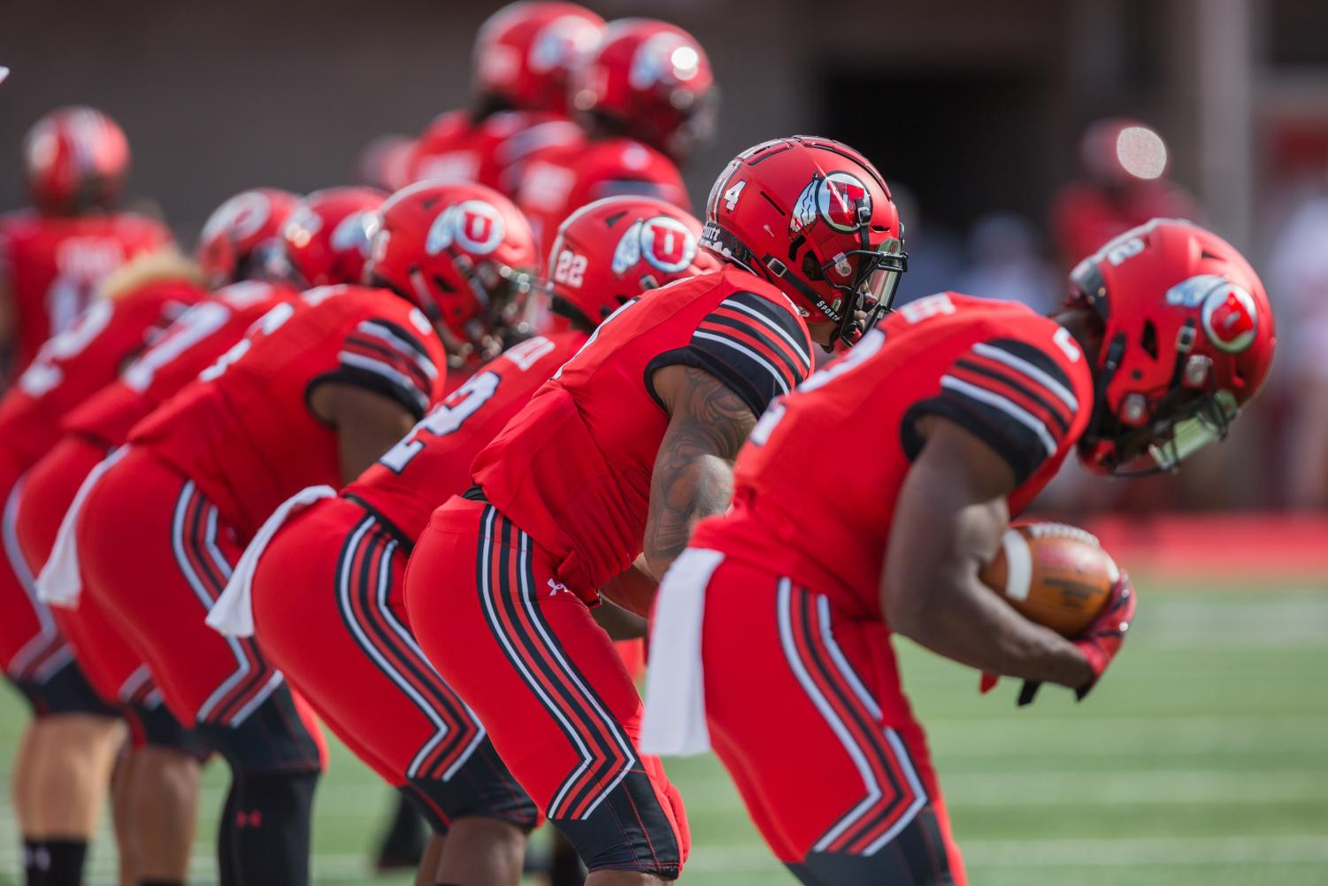 The University of Utah football team warms up before the NCAA football game vs. Weber State at Rice-Eccles Stadium in Salt Lake City, UT on Thursday August 30, 2018. (Photo by Curtis Lin | Daily Utah Chronicle)