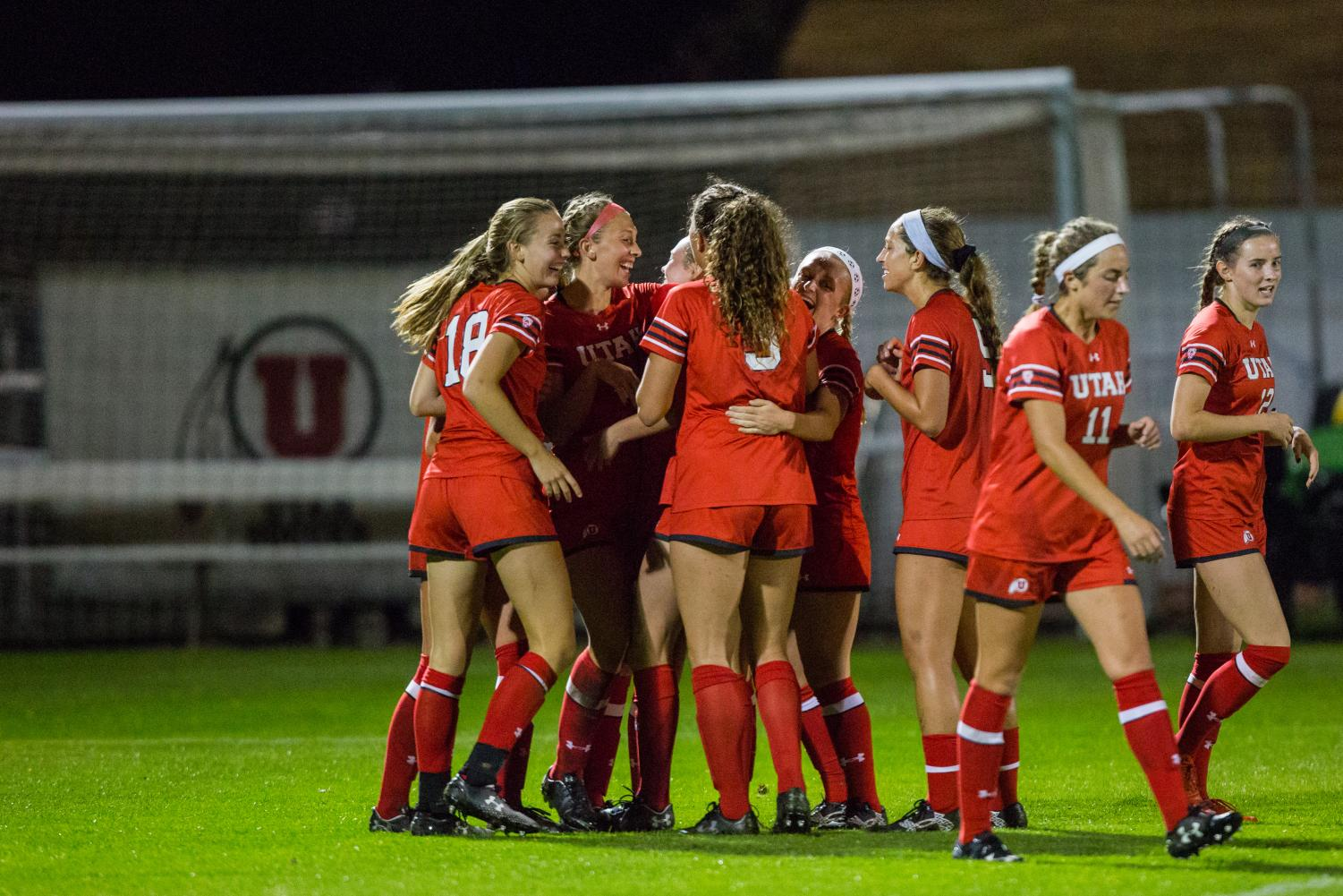The University of Utah Women's Soccer Team celebrated after a goal in an NCAA Women's Soccer game vs. Washington at Ute Soccer Field in Salt Lake City, UT on Thursday October 04, 2018.(Photo by Curtis Lin | Daily Utah Chronicle)