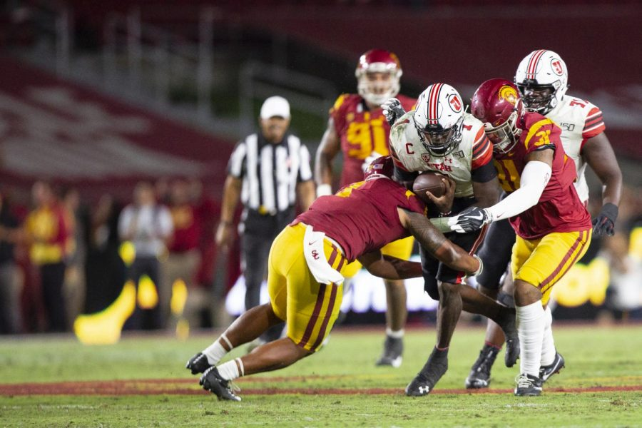 University of Utah senior quarterback Tyler Huntley (1) gets tackled after a short gain on the USC Trojan defense at the Los Angeles Memorial Coliseum on Sept. 20, 2019.(Justin Prather | The Daily Utah Chronicle).