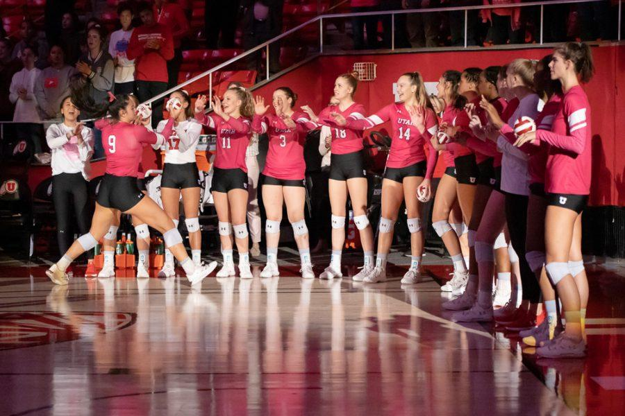 University of Utah Setter Saige Ka'aha'aina-Torres (9) cheers with her teammates during introducion in an NCAA Volleyball match vs. The Washington Huskies at the Jon M. Huntsman Center in Salt Lake City, Utah on Friday, Oct. 25, 2019. (Photo by Abu Asib | The Daily Utah Chronicle)