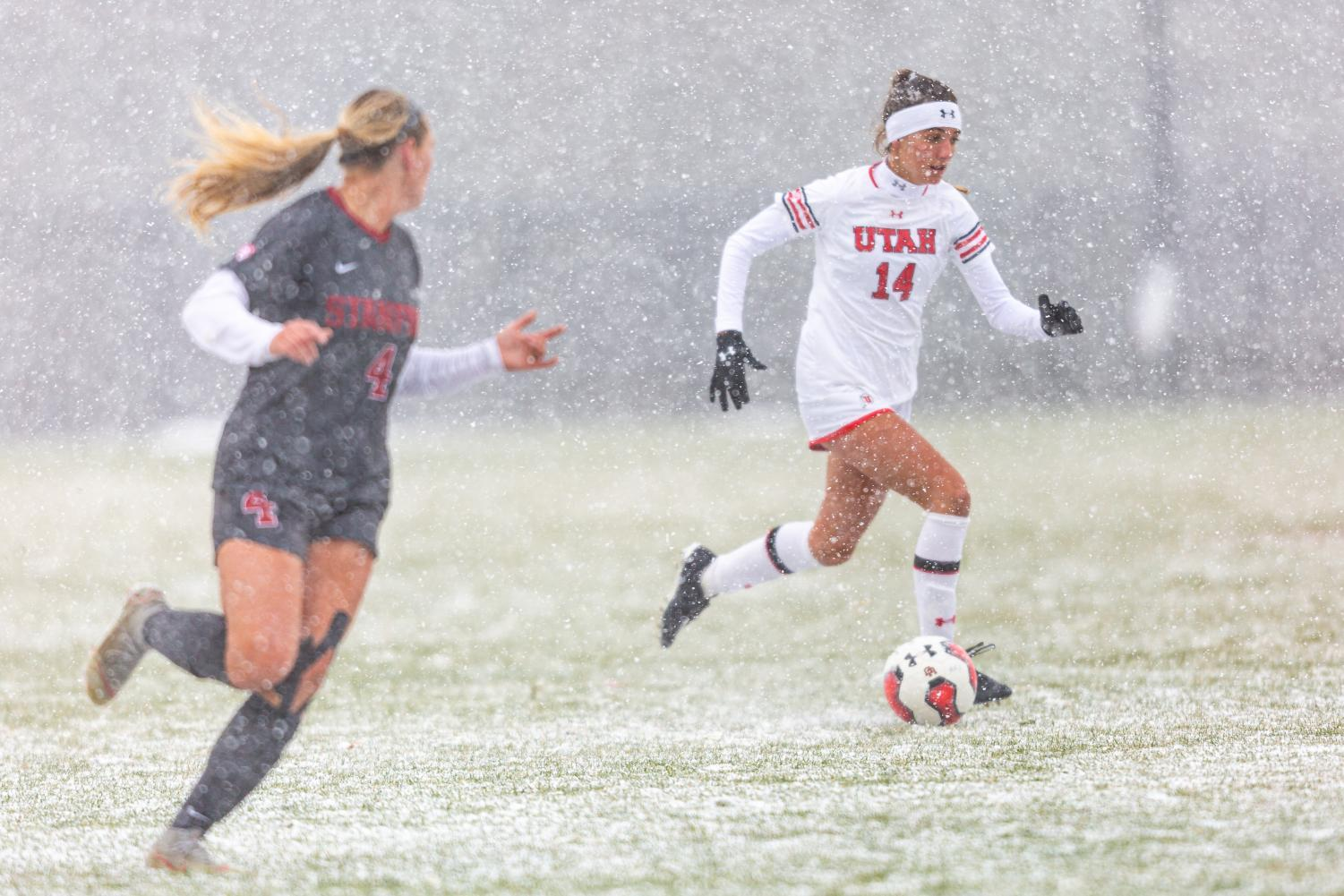 University of Utah Utes Women's soccer team midfielder Courtney Talbot (14) dribbles past during an NCAA soccer match vs. the Stanford Cardinal women's soccer team at the Ute Soccer Field in Salt Lake City, Utah on Sunday, Oct. 27, 2019 (Photo by Abu Asib | The Daily Utah Chronicle)