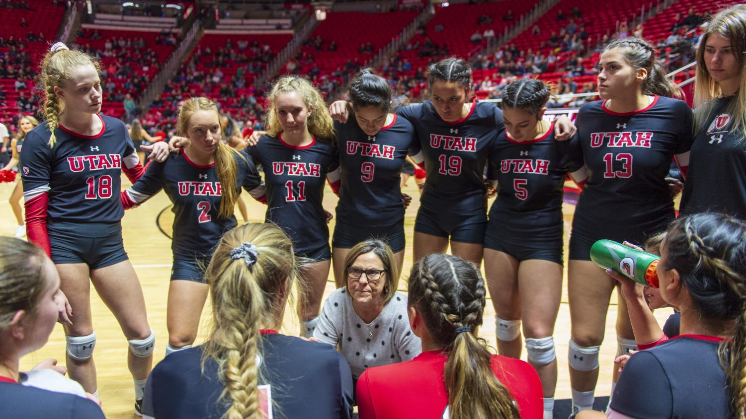The University of Utah women's volleyball team takes a timeout while head coach Beth Launiere discusses strategy during an NCAA Volleyball match vs. The Colorado Buffalos at the Jon M. Huntsman Center in Salt Lake City, Utah on Friday, Nov. 23, 2018. (Photo by Kiffer Creveling   The Daily Utah Chronicle)