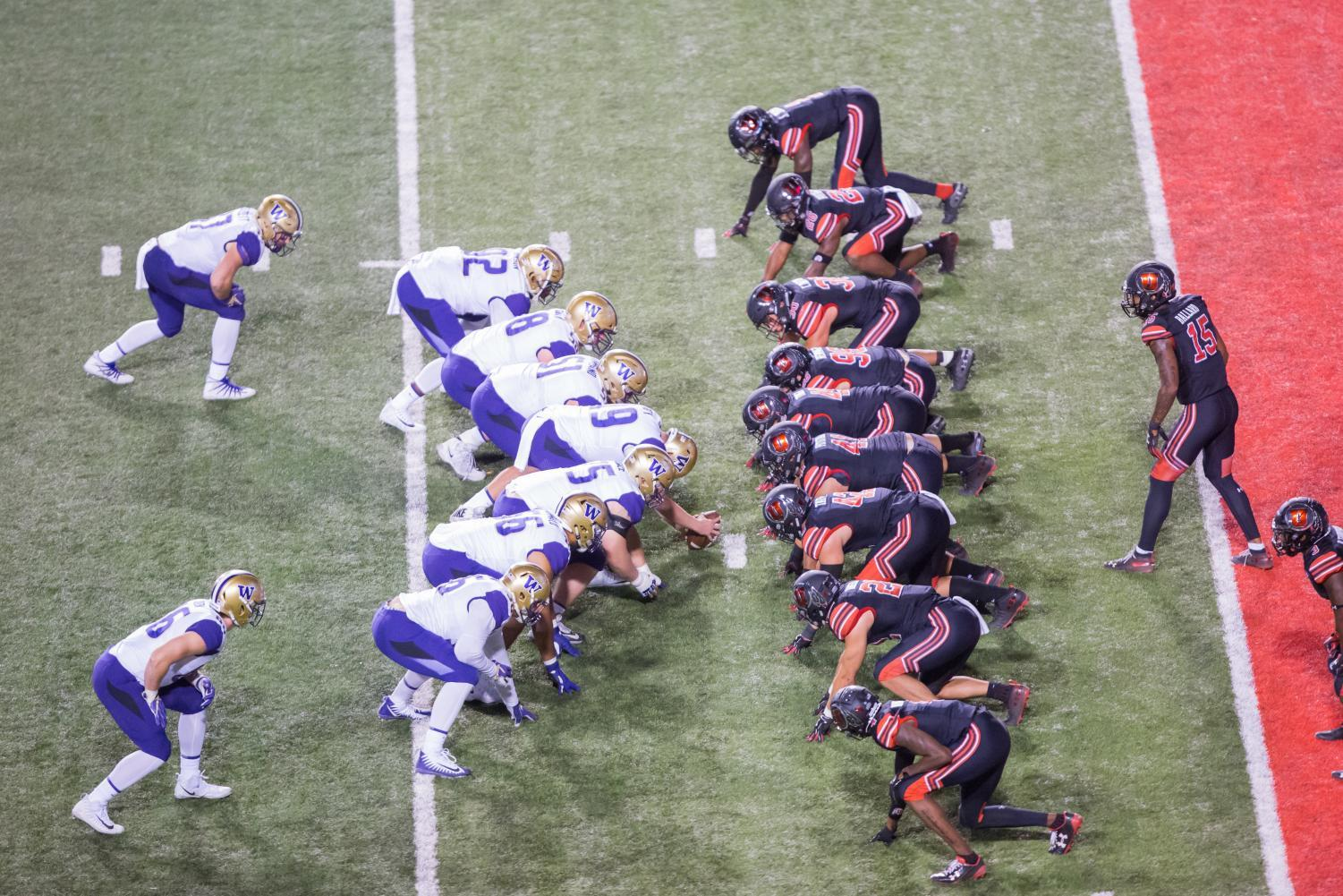 Both Univeristy of Utah and University of Washington line up prior to a snap in an NCAA football game vs. Washington at Rice-Eccles Stadium in Salt Lake City, UT on Saturday Sept. 15, 2018. (Photo by Curtis Lin | Daily Utah Chronicle)
