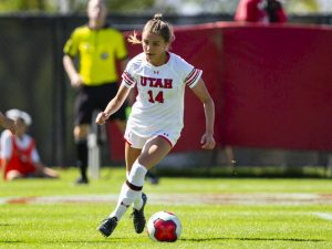 University of Utah freshman midfielder Courtney Talbot (14) dribbles the ball past University of San Diego sophomore defender Michaela Foster (13) in an NCAA Women's Soccer game vs. San Diego University at Ute Field in Salt Lake City, UT on Sunday September 22, 2019. (Photo by Curtis Lin | Daily Utah Chronicle)