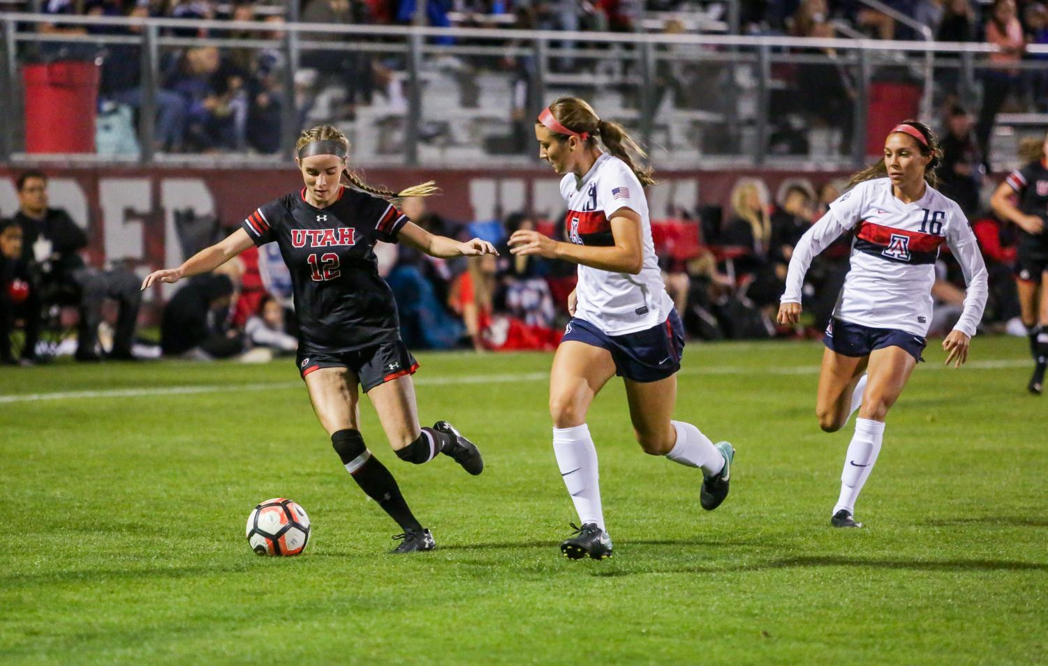 Holly Daugirda dribbles past an Arizona Defender as the Utah Women's Soccer Team takes on the Arizona Wildcats at Ute Soccer Field in Salt Lake City, UT on Thursday,Oct. 19, 2017.(Photo by Curtis Lin/ Daily Utah Chronicle)