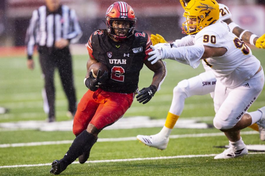 University+of+Utah+senior+running+back+Zack+Moss+%282%29+rushing+with+the+ball+after+taking+a+handoff+from+University+of+Utah+senior+quarterback+Tyler+Huntley+%281%29+in+an+NCAA+Football+game+vs.+Arizona+State+University+at+Rice-Eccles+Stadium+in+Salt+Lake+City%2C+UT+on+Saturday+October+19%2C+2019.%28Photo+by+Curtis+Lin+%7C+Daily+Utah+Chronicle%29