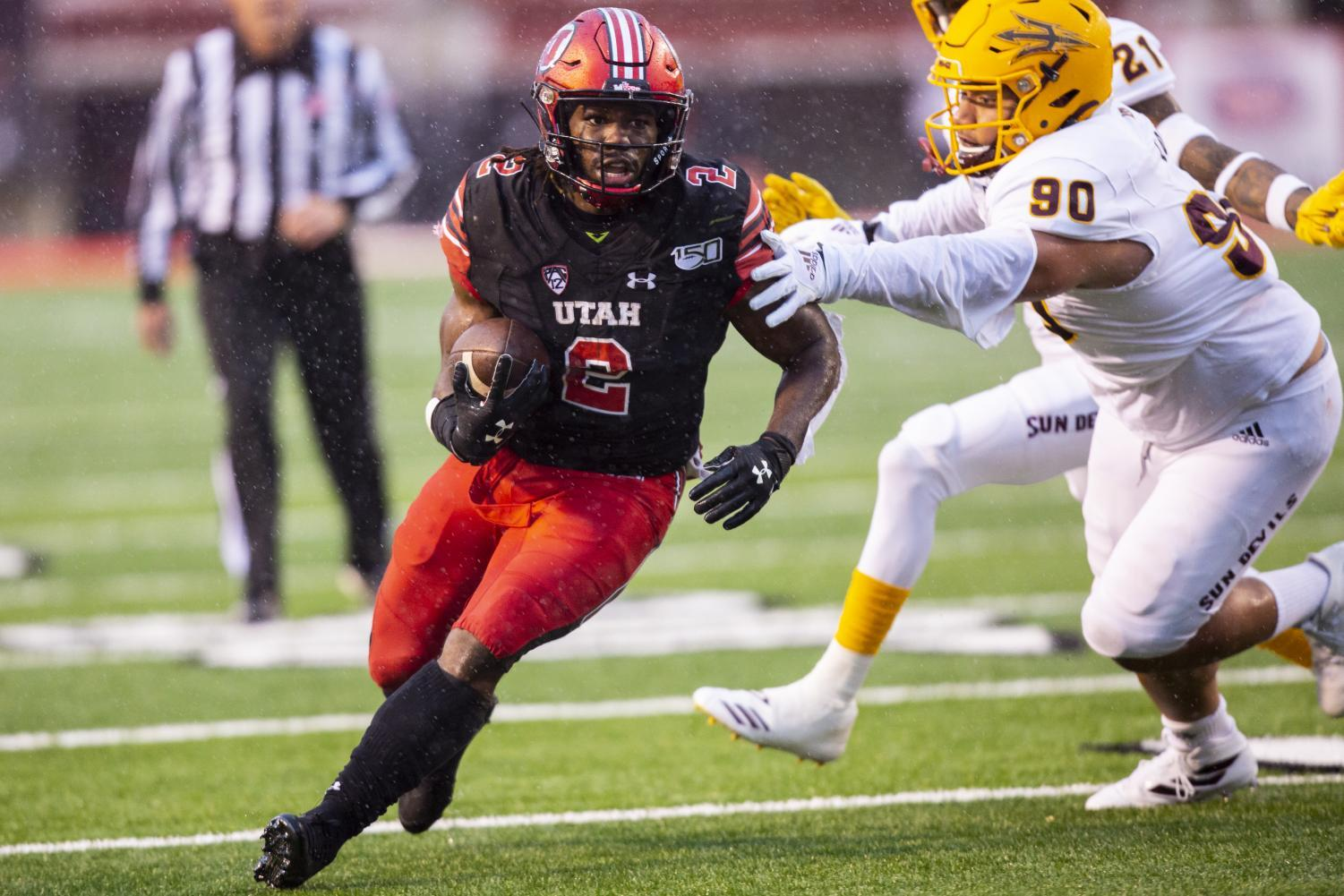 University of Utah senior running back Zack Moss (2) rushing with the ball after taking a handoff from University of Utah senior quarterback Tyler Huntley (1) in an NCAA Football game vs. Arizona State University at Rice-Eccles Stadium in Salt Lake City, UT on Saturday October 19, 2019.(Photo by Curtis Lin   Daily Utah Chronicle)