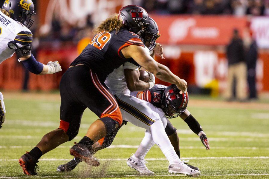 University+of+Utah+senior+defensive+tackle+Leki+Fotu+%2899%29+and+University+of+Utah+senior+defensive+back+Terrell+Burgess+%2826%29+tackle+a+rushing+University+of+California+player+in+an+NCAA+Football+game+vs.+University+of+California+at+Rice-Eccles+Stadium+in+Salt+Lake+City%2C+UT+on+Saturday+October+26%2C+2019.+%28Photo+by+Curtis+Lin+%7C+Daily+Utah+Chronicle%29