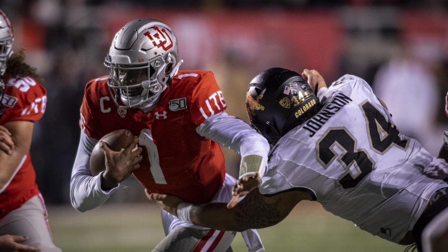 University of Utah senior quarterback Tyler Huntley (1) runs the ball past University of Colorado junior defensive end Mustafa Johnson (34) during an NCAA Football game at Rice Eccles Stadium in Salt Lake City, Utah on Saturday, Nov. 30, 2019. (Photo by Kiffer Creveling | The Daily Utah Chronicle)
