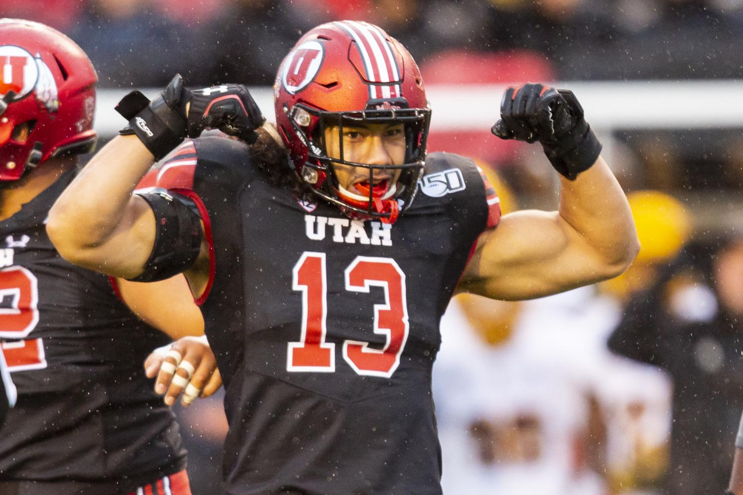 University of Utah senior linebacker Francis Bernard (13) celebrating after tackling Arizona State University freshman quarterback Jayden Daniels (5) in an NCAA Football game vs. Arizona State University at Rice-Eccles Stadium in Salt Lake City, UT on Saturday October 19, 2019.(Photo by Curtis Lin | Daily Utah Chronicle)