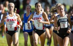 University of Utah senior Sarah Newton (31) and University of Utah sophomore Kennedy Powell (32) during the Women's 5K run at the Utah Open in an NCAA Cross Country Meet at Sunnyside Park in Salt Lake City, UT on Friday Oct. 25, 2019. (Photo by Curtis Lin | Daily Utah Chronicle)