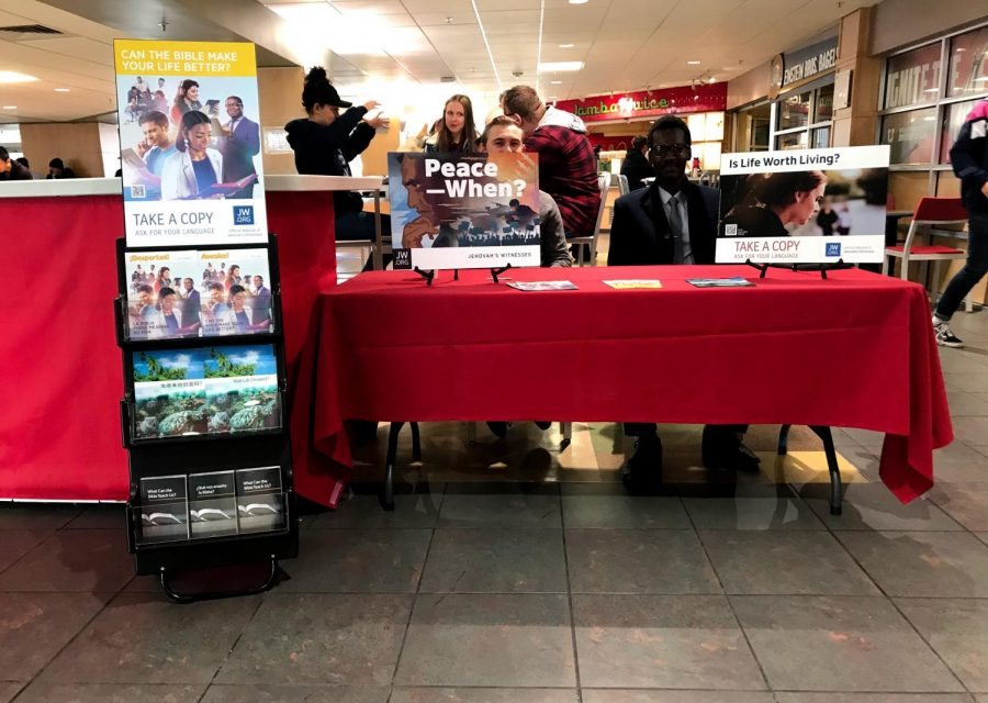 Jehovah's Witnesses inside the food court. (Photo by Natalie Colby | Daily Utah Chronicle)