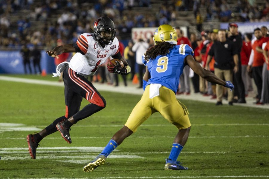 University of Utah junior quarterback Tyler Huntley (1) keeps the ball during an NCAA Football game at the Rose Bowl in Pasadena, CA on Friday, Oct. 26, 2018. (Photo by: Justin Prather | The Utah Chronicle).
