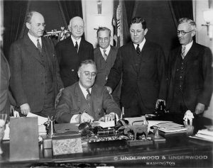 President Franklin D. Roosevelt signs the Gold Reserve Actt on Jan. 30, 1934. (Courtesy Wikimedia Commons)