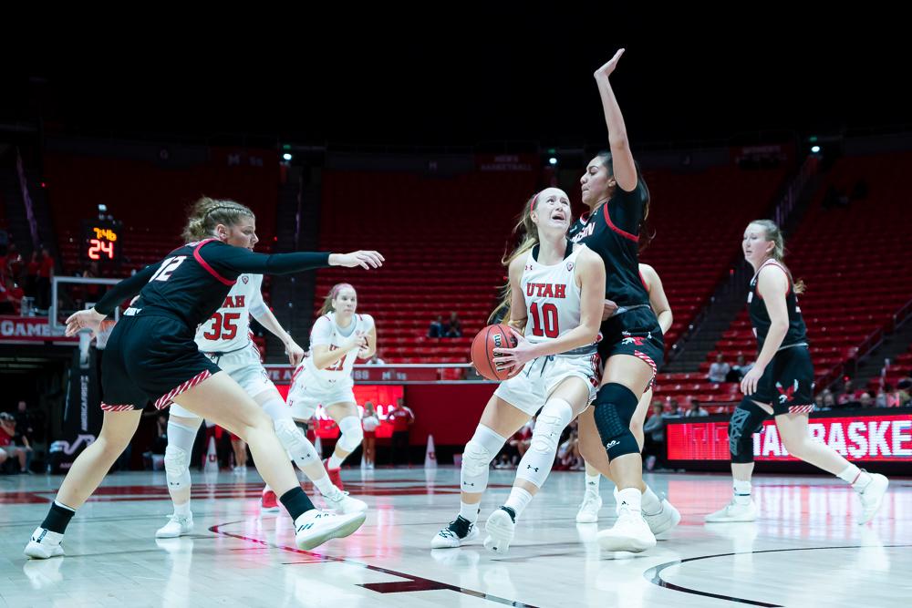 University of Utah Utes Women's Basketball Team Guard Dru Gylten (10) battles to score during an NCAA Basketball match vs. the Eastern Washington Eagles at the Jon M. Huntsman Center in Salt Lake City, Utah on Monday, Nov. 18, 2019. (Photo by Abu Asib | The Daily Utah Chronicle)