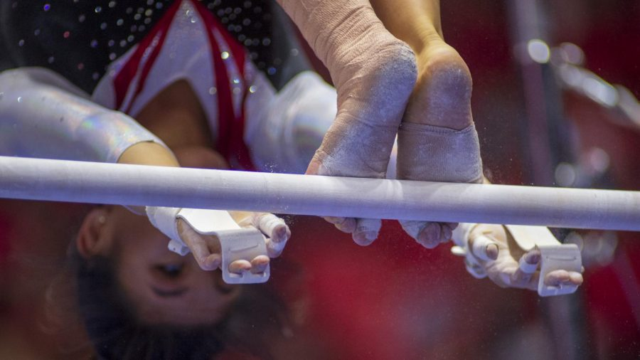 University of Utah womens gymnastics freshman Cristal Isa performs on the uneven bars in the Red Rock preview at the Jon M. Huntsman Center in Salt Lake City, Utah on Friday, Dec. 7, 2018. (Photo by Kiffer Creveling | The Daily Utah Chronicle)