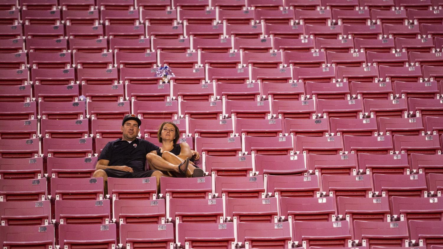 A couple fans wait in the stands at Rice Eccles Stadium after a 21-7 loss to the Washington Huskies on Sat. Sept. 15, 2018.(Photo by: Justin Prather | The Utah Chronicle).