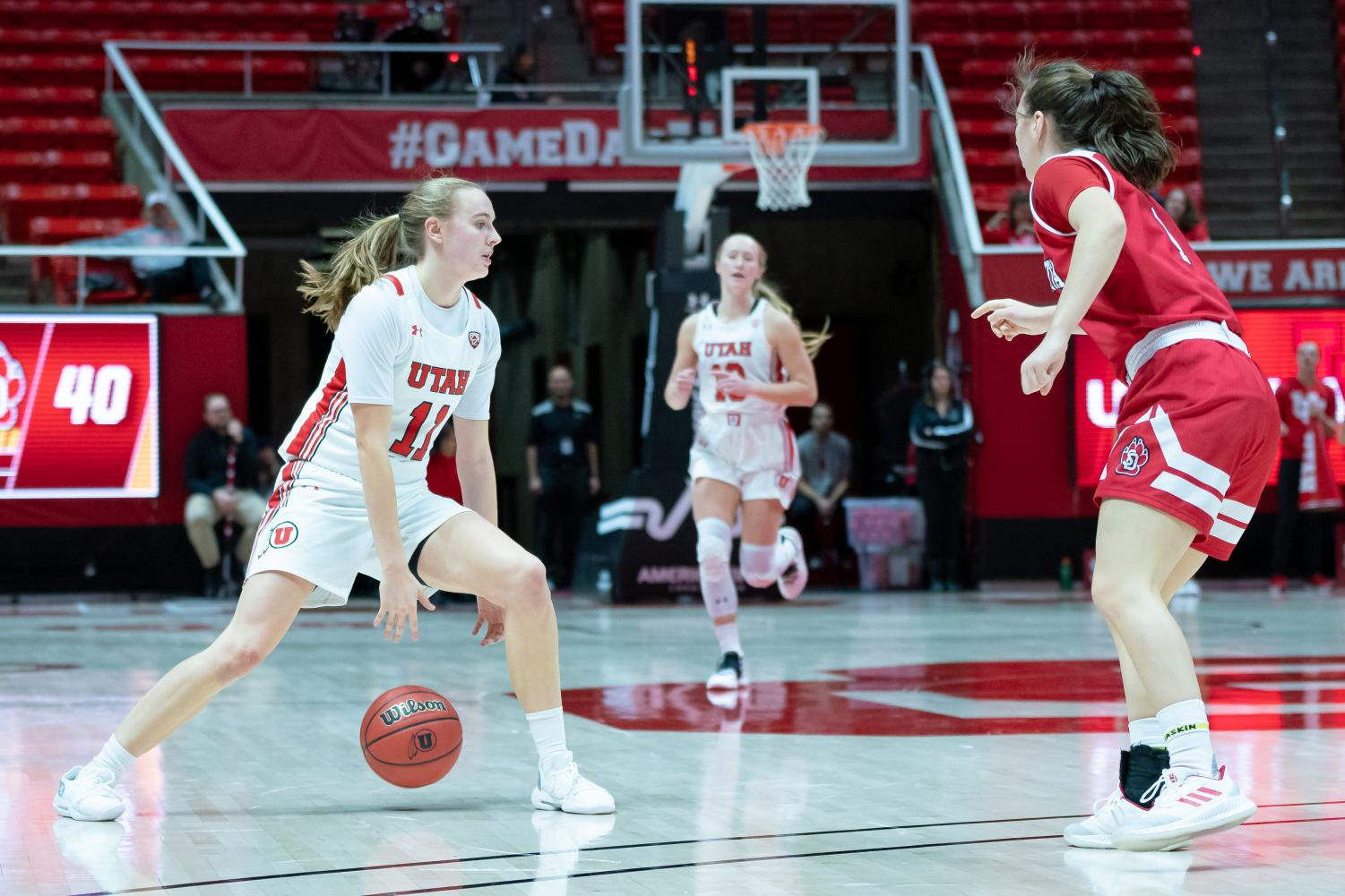 University of Utah Utes Women's Basketball Team Guard Bryanna Maxwell (11) looks to pass the ball during an NCAA Basketball match vs. the South Dakota Coyotes at the Jon M. Huntsman Center in Salt Lake City, Utah on Saturday, Nov. 16, 2019. (Photo by Abu Asib | The Daily Utah Chronicle)
