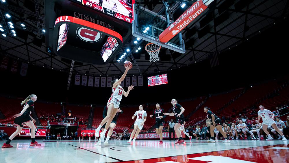 University of Utah Utes Women's Basketball Team Wing Niyah Becker (14) scores during an NCAA Basketball match vs. the Eastern Washington Eagles at the Jon M. Huntsman Center in Salt Lake City, Utah on Monday, Nov. 18, 2019. (Photo by Abu Asib | The Daily Utah Chronicle)