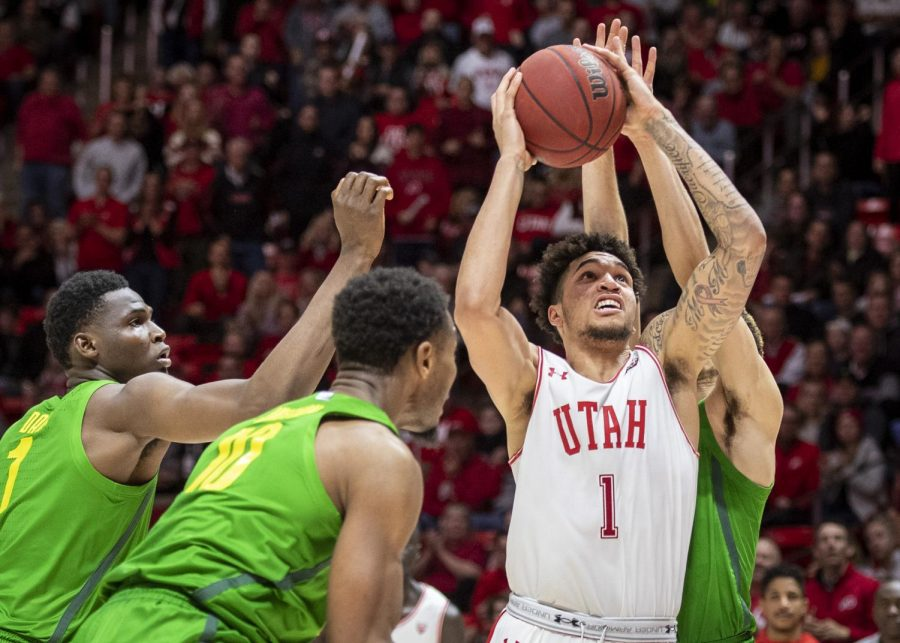 University of Utah sophomore forward Timmy Allen (1) reaches for the basket through Oregon defense during an NCAA Basketball game at the Jon M. Huntsman Center in Salt Lake City, Utah on Saturday, Jan. 4, 2020. (Photo by Kiffer Creveling | The Daily Utah Chronicle)